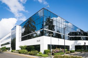 blue sky reflected off modern business building