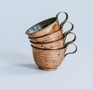 copper mugs stacked